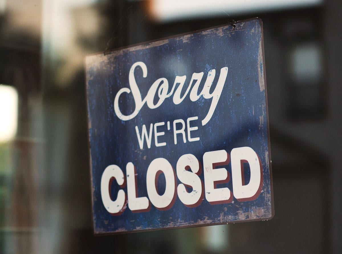 Closed store sign due to COVID-19 pandemic
